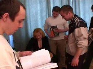 A mature woman fucks five young boys