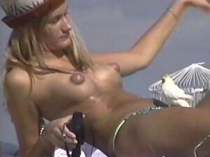 Blonde with puffy nipples topless on the beach
