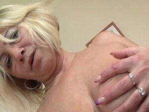 Lusty mature tramp  fingering her juicy snatch