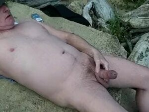 naked and displaying dick on the public beach
