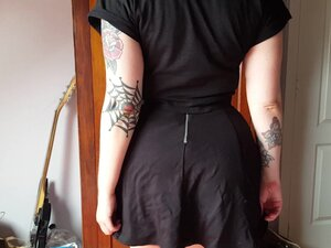 Inked Goth Emo girl flashes her purple panties