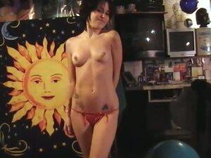 Breathtaking brunette stripteasing before getting