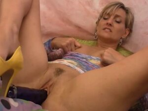 Short haired blonde playing with her toys
