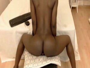 Black short-haired colombian Girl shaking toying