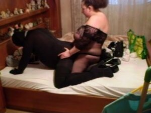 BBW Mistress fucking her man with a strap on
