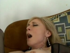 Mature blonde whore sucks and fucks young cock on