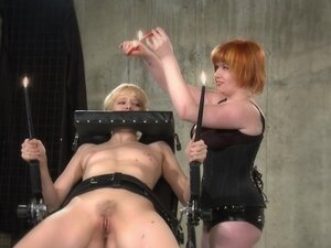 Dominant redhead covers her slave's body with hot