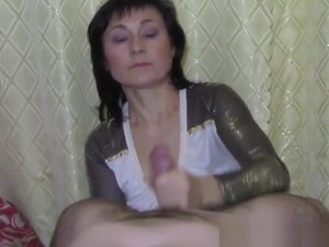 Mature Gives Very Sloppy Handjob,