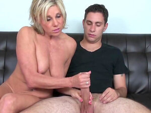 Busty mom strokes cock in naughty manners