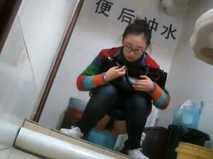 Nerdy chinese girl caught taking a leak, This