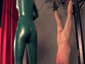 Redhead latex domina queens while giving CBT