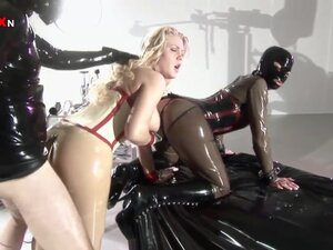 Two babes in latex being banged