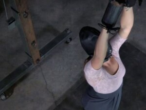 Slave mask sub has her arms chained up