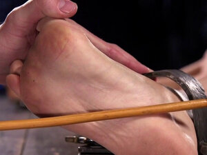 Blonde in bondage pussy fingered