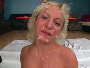 Disgusting blonde whore enjoys a bukkake gangbang,
