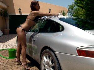 Smoking hot chick Venus is washing a damn good car