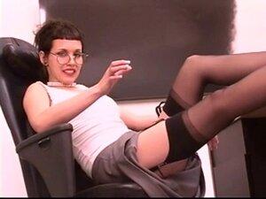 Horny secretary removes glasses and masturbates