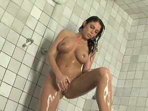 Busty brunette Jessica DiFeo is getting wet under