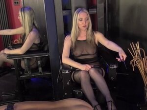 Mistress dominating subject with machine