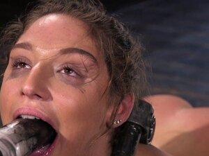 Bound brunette endurs pain from huge dildo