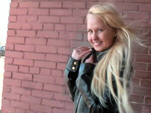 Flashing teen in skirt and leather jacket