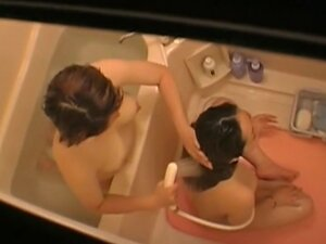 Charming Asian teens sitting nude under shower