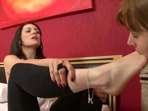 She licks the mistresses feet