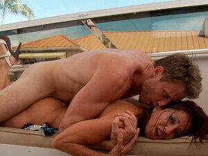 Busty brunette Tara Holiday rides on cock in