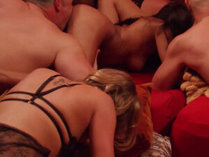Swingers interact sexually with each other in the