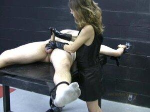 Mistress in latex gloves masturbates a naked, tied