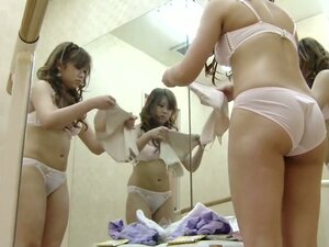 Dressing room girl puts on tricot and fishnet