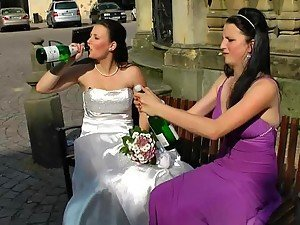 Bride and Maid of Honor Getting Wet With Champagne