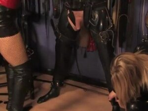 Dominas put gimp in a straight jacket