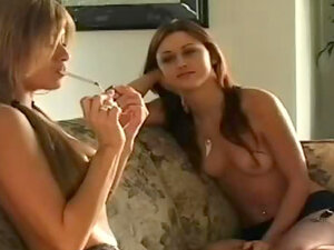 Naked girls smoke on the couch
