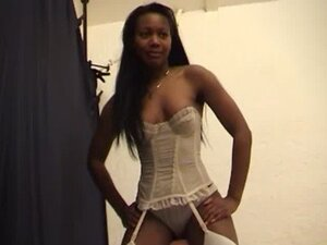 Black woman in white lingerie controls a guy