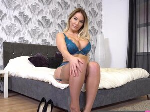 Sexy UK blonde with big tits gets nude