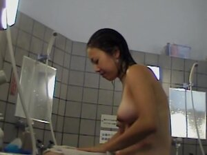 One very cute Asian chick shows her pussy and tits