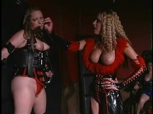 Thick woman tied with leather restraints,