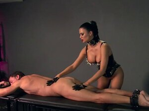 Busty mistress bangs strapped slave to cumshot