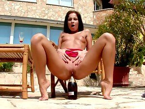 Patio soloist sticks a bottle of wine in her wet