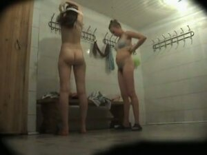 Two naked amateurs dressing up on changing room