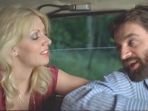 Vintage threesome in the car in a public road,