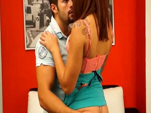 Arousing couple kiss passionately at their living