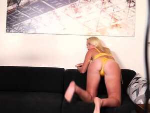 Tattooed blonde hottie shows off in a bikini