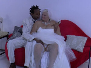 Horny granny enjoys black cock in her pussy