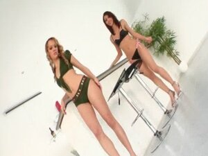 Appealing lesbian couple strips sexy lingerie to