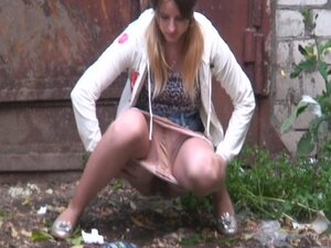 Candid amateur girl gets spied pissing in the