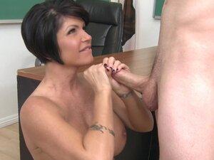 Short-haired bosomy brunette Shay Fox blows cock