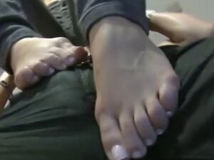 Fetish babe caresses cock with feet