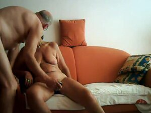 Real couple having sex on their orange sofa